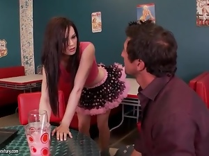 Sexy waitress in short skirt gives footjob