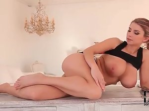 Flexible girl licks her toes and rubs boobs