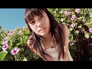Soft white dress on Japanese beauty outdoors