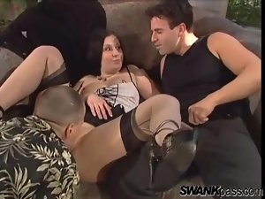 Curvy girl dressed in stockings for anal threesome