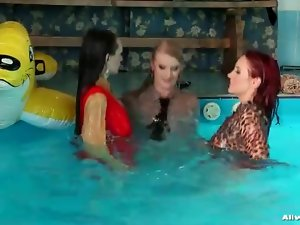 Cute ladies bouncing in the pool in sexy clothes