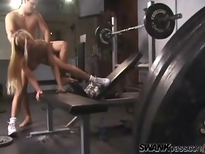Sex in the gym with a fake titty blonde girl