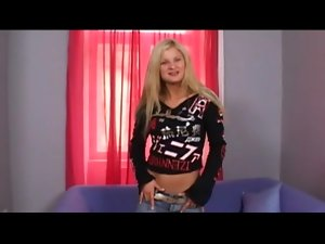 Teen blonde in jeans does a striptease for you