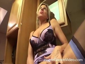 His housewife in lingerie sucks cock in kitchen