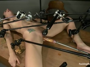 Chastity Lynn enjoys playing with a sex machine in a classroom