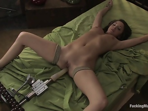 Charlie Laine gets fucked to orgasm by a sex machine indoors