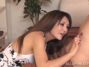 Charming Japanese milf gathers some cum in a condom