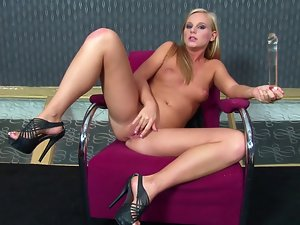 Rebecca enjoys pounding her snatch with a glass toy