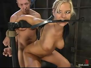 Sexy blond gets nailed in her twat in bondage device