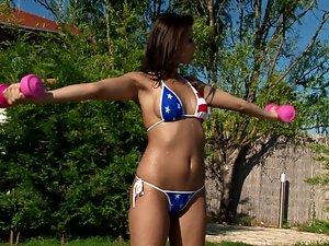 Delightful Klaudia poses in bikini and masturbates outdoors