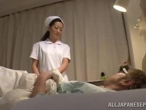 Mature Japanese nurse gives a handjob and gets fucked