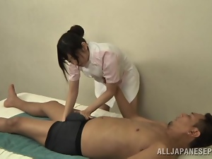 Petite Japanese masseuse rides a dick passionately