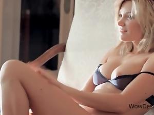 Blonde hottie touching big full tits in erotic scene