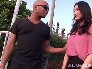 Risa Murakami gets her mouth and pussy fucked hard on a beach