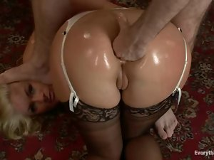 Gorgeous nurse gets her holes fisted and fucked in MMF threesome