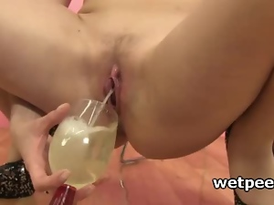 Babe masturbating drinks and dives in her own piss