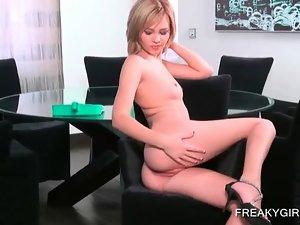 Naked blonde nymph masturbating her peachy twat