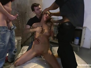 Chained brunette girl gets gangbanged by her masters