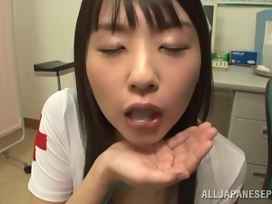 Lewd Japanese nurse Tsubomi milks two dicks dry on her face