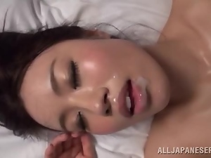 Lovely Japanese babe gets her pussy drilled on a bed