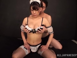 Japanese slut gets fucked doggy style while sucking a prick