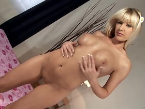 Natalli boasts of her terrific boobs and tests her new dildo