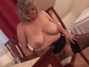 Sexy mature blonde touching her soft pussy with lust