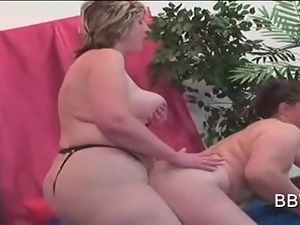 BBW lesbian doggy style fucking with strap-on