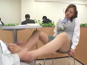 Kinky Japanese chick gives a footjob to a stranger