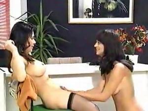 Two sexy long-legged girls enjoy playing lesbian games in a study