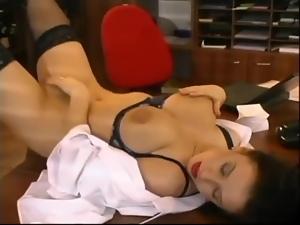 Busty brunette secretary enjoys doggy style sex on a desk