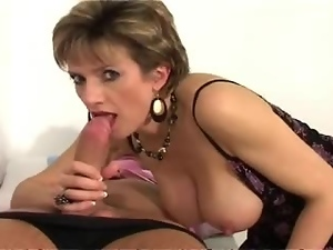 Mature blonde gives an amazing blowjob and gets jizzed on her legs