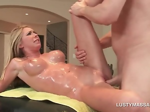 Sexy blonde gets bald cunt nailed on massage table