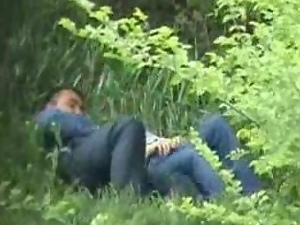Horny couple feels an urge to caress each other in a park