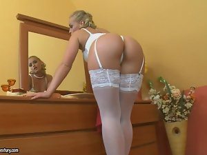 Sexy blond honey Kathia Nobili looks great in white