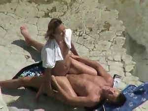 Horny couple banging on a beach caught on a voyeur's cam