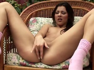Charming brunette moans sweetly while drilling her cunt with a toy