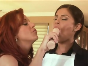 Redhead milf has a lesbian 69 with a young brunette