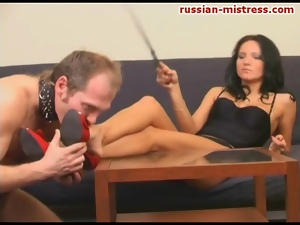 Sexy woman makes him worship her feet