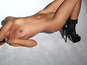 Her long legs are sexy in black pantyhose