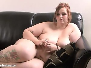 Very pretty tattooed BBW Milla smokes naked on the couch