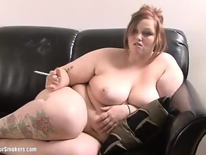 Big chubby cutie with tattoos smokes whilst naked