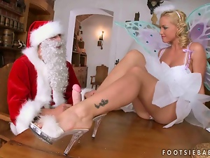 Kathia Nobili enjoys foot sex with a Santa