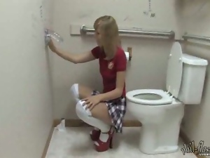 Teens fucks dildo in a toilet