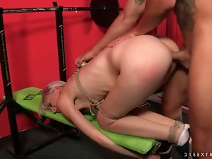 Girl gets tied up and fucked hard in the gym