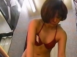 Young japanese tries on bathing suits