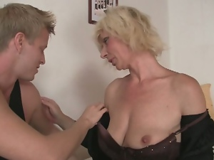 Attractive granny takes it from behind