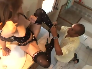 Flexible young lady gives footjob in the bathroom