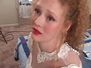 Redhead in wedding dress models her pussy