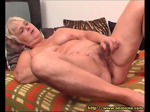 Old lady rubs wet dildo around her pussy